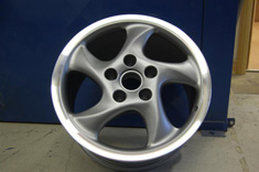 "18"" Twist Porsche alloy wheel in grey and polished outer rim"