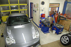 Porsche 996 in seal grey inside the TWR workshop